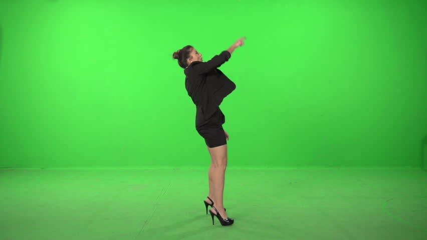 Dancer dressed as business woman dance and throw papers on a green screen backround - HD stock footage clip