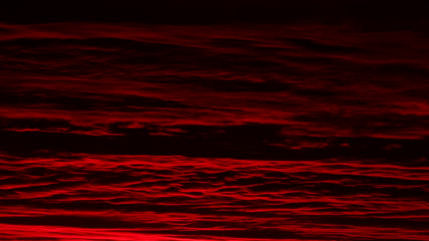 Red Cloud Dawn. Clouds with a red hue during dawn sunrise, shot in time-lapse.