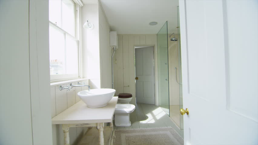 View of elegant bathroom in a stylish, classically designed home with a contemporary feel. No people.