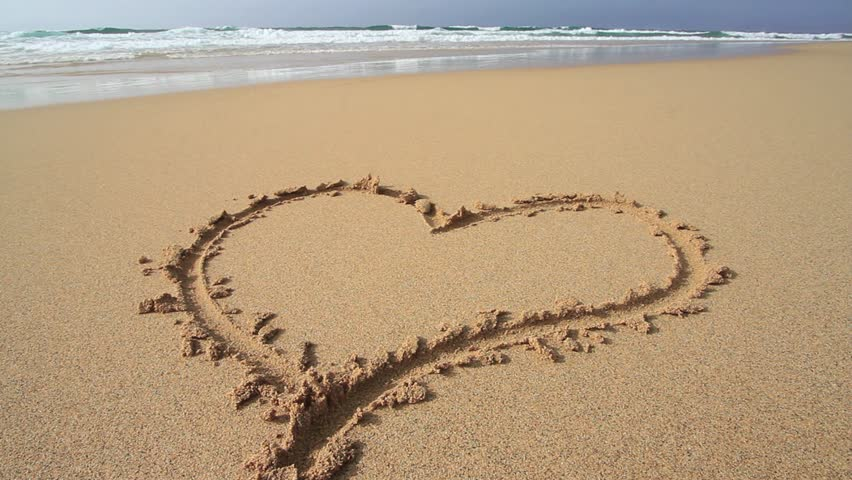 Heart Being Washed Away On Sandy Beach - HD stock footage clip