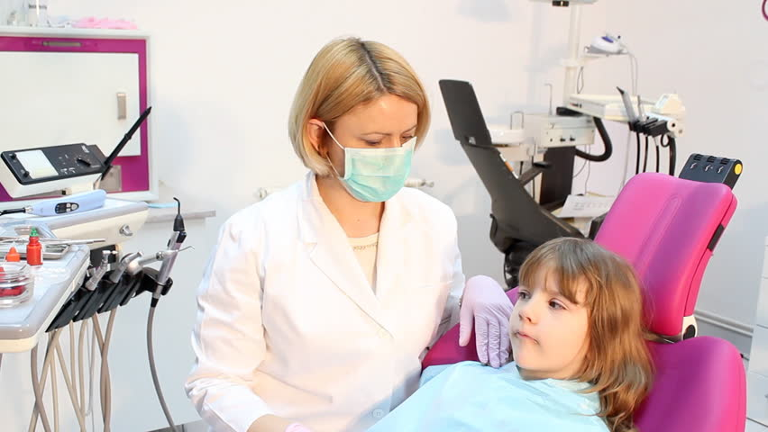 female dentist examines teeth a little girl - HD stock footage clip