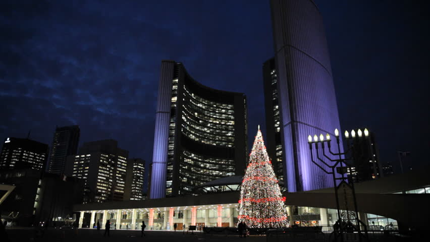 Evening At Toronto City Hall With The Christmas Tree Light Up And Purple Lights On The City Hall Building In Support Of Pancreatic Cancer Charities.