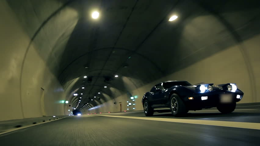 Low Angle Diagonal Shot Of Car Driving Through The Tunnel