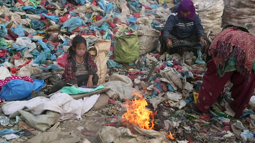 KATHMANDU, NEPAL - DEC 19: Unknown poor children makes the lessons on the dump,