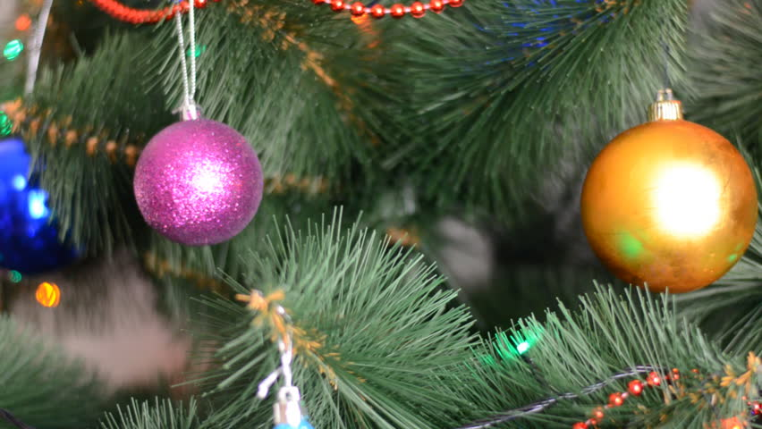 Green Christmas Tree with Gifts and Bulbs, Rack Focus and Dolly In Out | Shutterstock HD Video #5286980