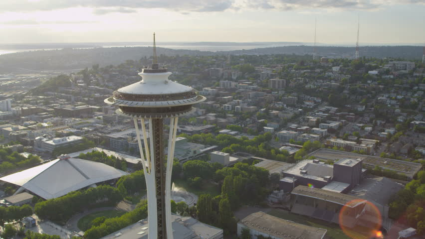Seattle - July 2013: Aerial sun flare view Space Needle Observation Tower Seattle residential suburbs Puget Sound, Washington, Pacific Northwest, USA - 4K stock footage clip