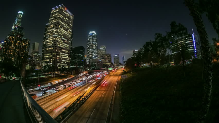 City traffic panning time lapse in downtown Los Angeles at night.