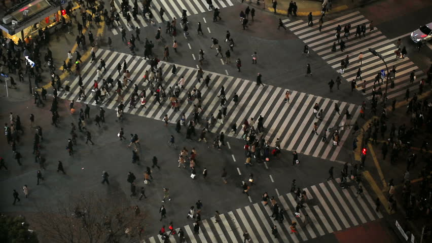 City pedestrian traffic of people crossing the famous Shibuya intersection at night in Tokyo. | Shutterstock HD Video #5289923
