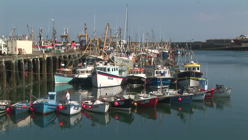 Row of colorful fishing boats in harbor Penzance UK - HD stock video clip