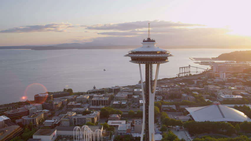 Seattle - July 2013: Aerial close up sun flare view at sunset Seattle Space Needle Elliot Bay, Puget Sound, Washington State, Pacific Northwest, USA, RED EPIC, 4K, UHD, Ultra HD resolution