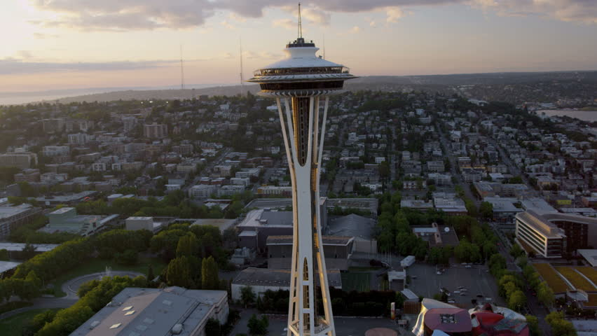 Seattle - July 2013: Aerial close up sun flare view at sunset Seattle Space Needle Elliot Bay, Puget Sound, Washington State, Pacific Northwest, USA, RED EPIC, 4K, UHD, Ultra HD resolution - 4K stock footage clip