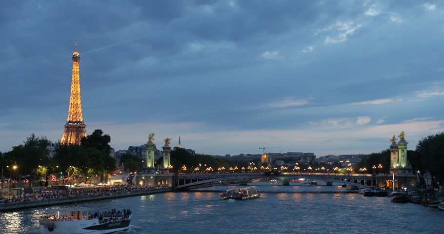 PARIS, FRANCE - JULY 25, 2013 Illuminated Night in Paris Skyline with Eiffel Tower and Alexander III Bridge Pont in Dusk Light ( Ultra High Definition, Ultra HD, UHD, 4K, 2160P, 4096x2160 ) | Shutterstock HD Video #5326940