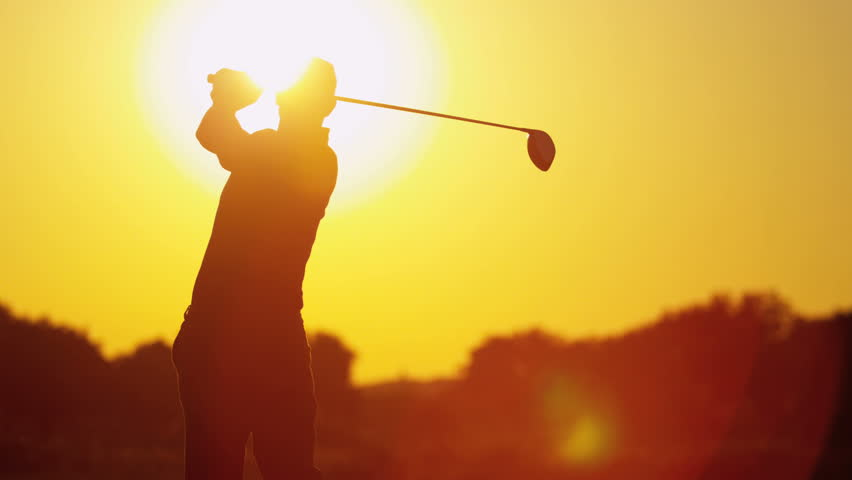Silhouette male golfer enjoying time golf course in summer driving off down fairway into setting sun shot on RED EPIC, 4K, UHD, Ultra HD resolution