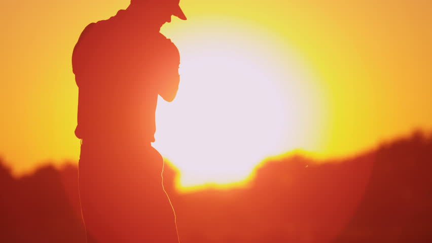 Male Caucasian golf professional practicing his swing on green before teeing off in silhouette sunset shot on RED EPIC, 4K, UHD, Ultra HD resolution - 4K stock footage clip