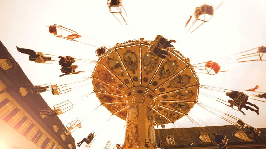 Carousel roundabout. swinging turning around .amusement carnival activity fun. 1080