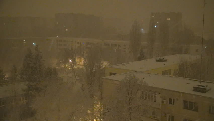 Snowing in Night, Snow Fall, Christmas Scene, Winter View in Town, District - HD stock footage clip
