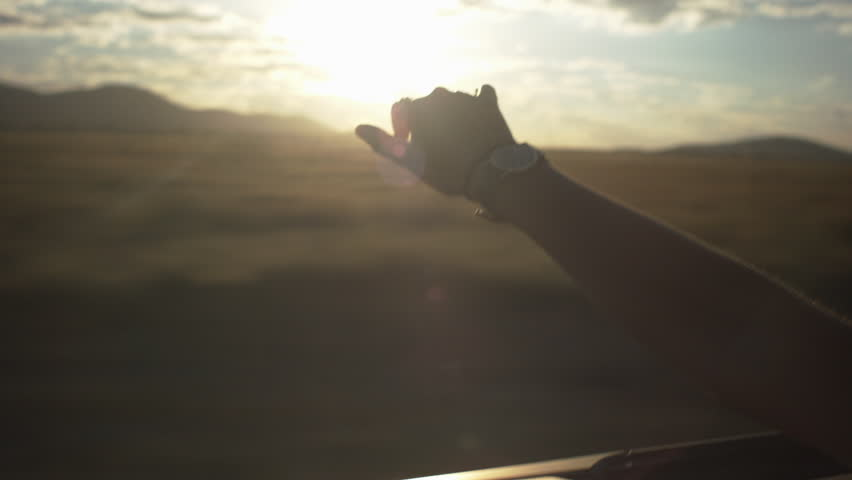 Teen Waves Her Hand In The Wind In A Convertible | Shutterstock HD Video #5364641