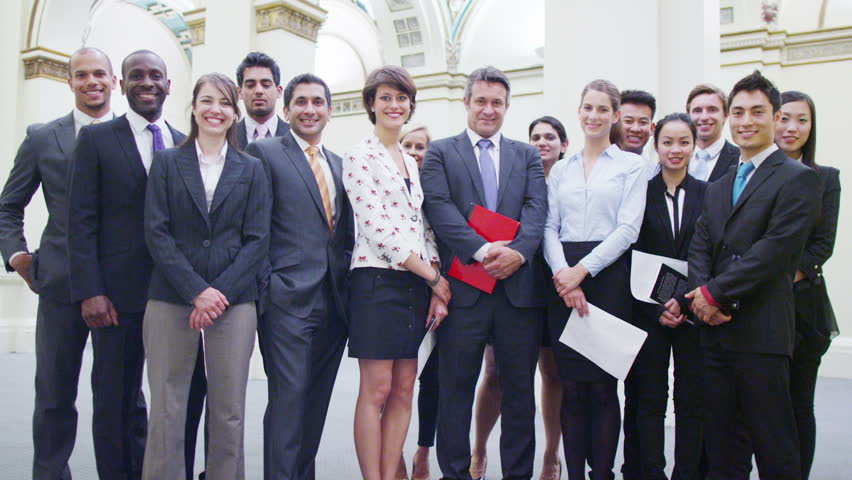 Portrait of confident and successful business team standing in historic building