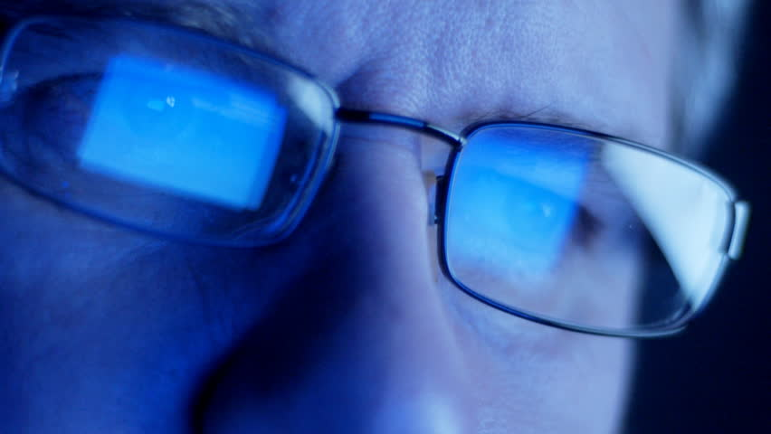 Computer screen and code reflected in man's glasses - HD stock footage clip