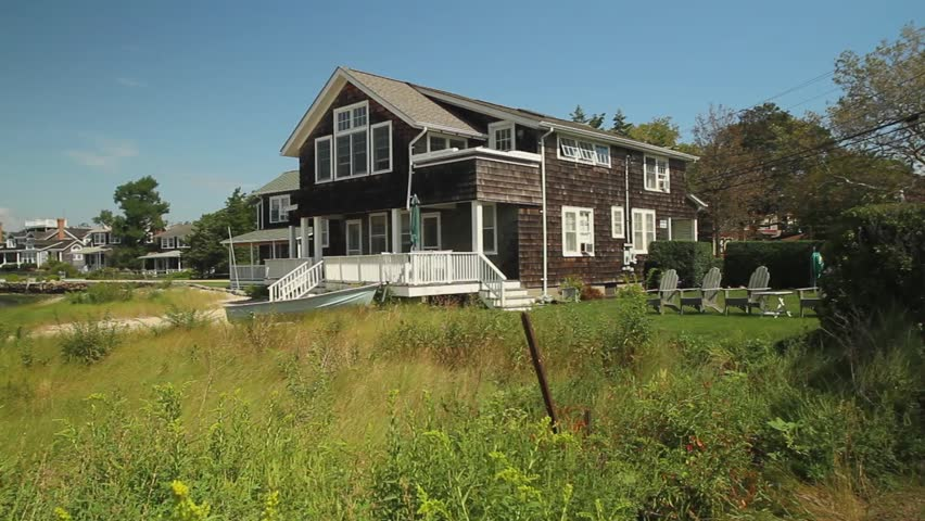 New England style house overlooking water (1 of 2)