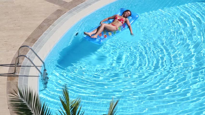 Young Girl In Swimsuit Sleeps Air Mattress In Outdoor