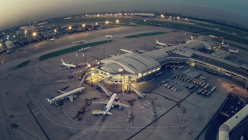 A timelapse clip of airport terminal shot from a control tower at sunset. | Shutterstock HD Video #5392802