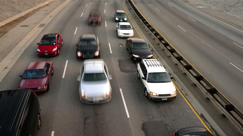 Highway Traffic 15 Pan R Loop Timelapse Highway Sunset - 4K stock video clip