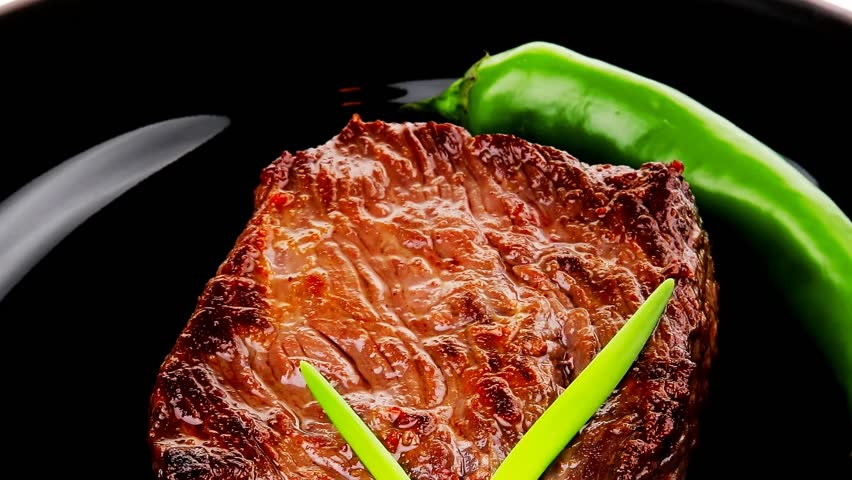 meat food : roast beef fillet mignon served on black plate with chili pepper 1920x1080 intro motion slow hidef hd