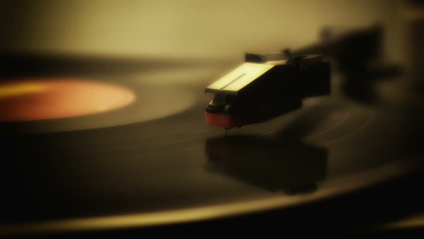Record player turntable HD stock footage. A record player turntable with it's stylus running along a vinyl record