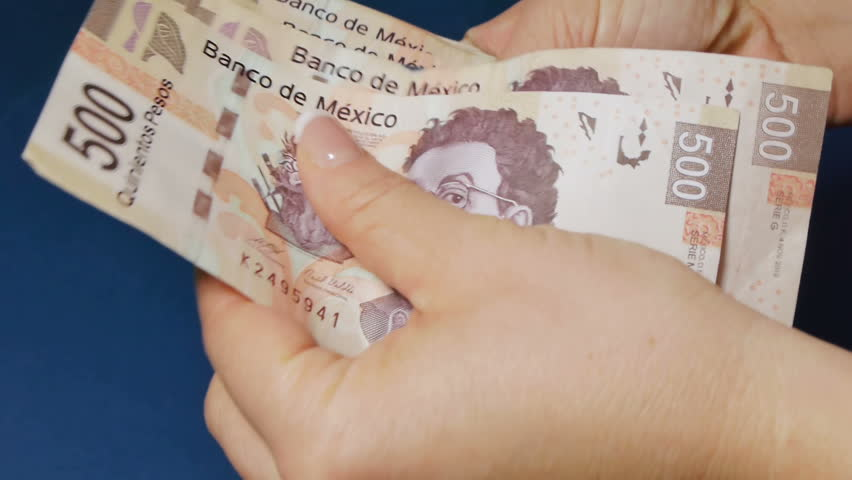 Counting Mexican High Denomination Money And Fanning it out.