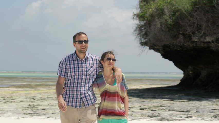 Young happy couple in love walking on exotic beach  - HD stock video clip