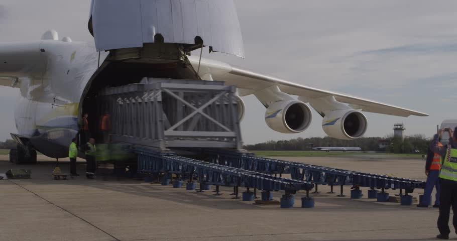 ZAGREB, CROATIA - NOVEMBER 10: Loading heavy weight cargo to the Antonov 225 Mriya airplane on November 10, 2013 Zagreb, Croatia. It is the biggest airplane in the world.