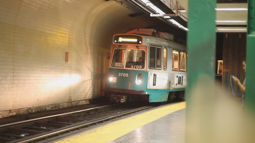 BOSTON - SEPTEMBER 2013: A MBTA Boston green line train arrives at an underground station locals call it The T.