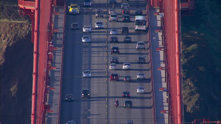 San Francisco Golden Gate Bridge. The scene shows the city of San Francisco. The shot focuses on the traffic on the Golden Gate Bridge. - HD stock video clip