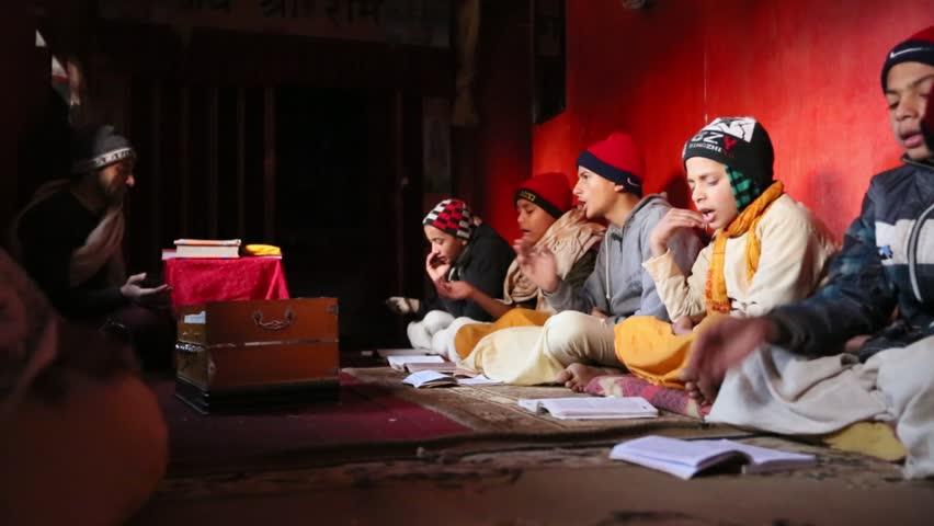 KATHMANDU, NEPAL - DEC 9: Unknown children during the reading of texts in Sanskrit at Jagadguru School, Dec 9, 2013 in Kathmandu, Nepal. School established at 2013 to let preserve Hindu culture. - HD stock video clip