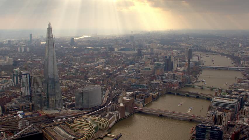 4K Aerial shot of Central London with view of the River Thames, Shard, London Bridge Railway Train Tracks, London Eye