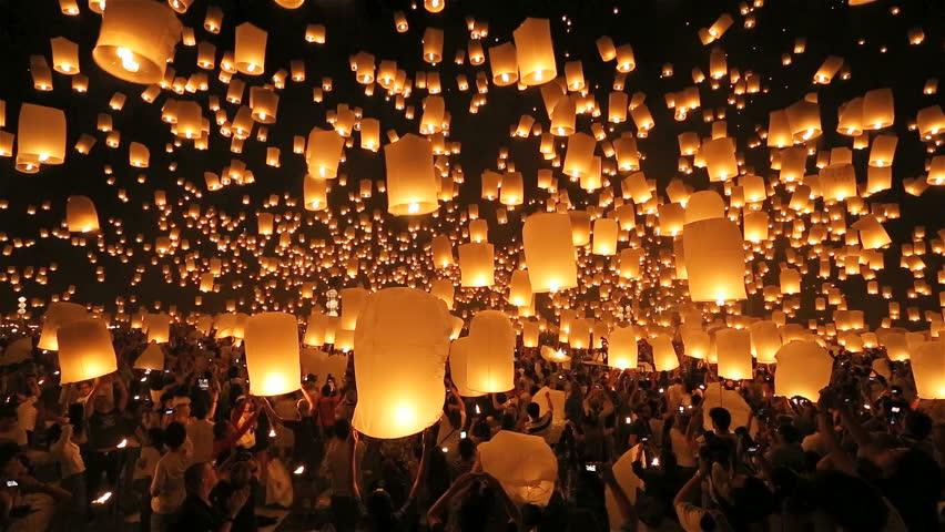 SANSAI, CHIANGMAI, THAILAND - NOV 16: Thousand of sky lanterns release at Loi Krathong celebration during Yee Peng Festival in Chiangmai Mae Jo University, Thailand on November 16, 2013 - HD stock footage clip