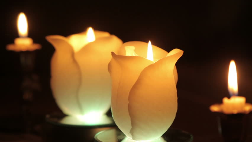 Burning candles in the dark in front of the mirror   Shutterstock HD Video #5539385