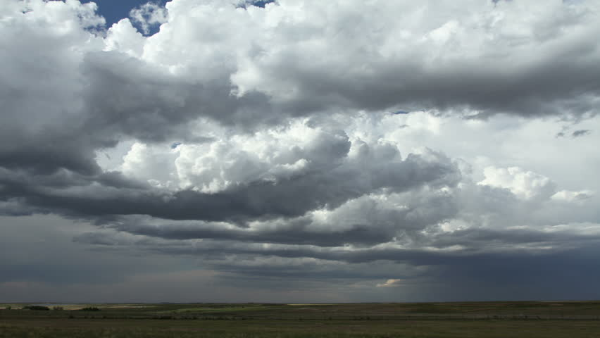 Massive thunderstorm clouds over rural eastern Colorado during tornado season. HD 1080p timelapse.