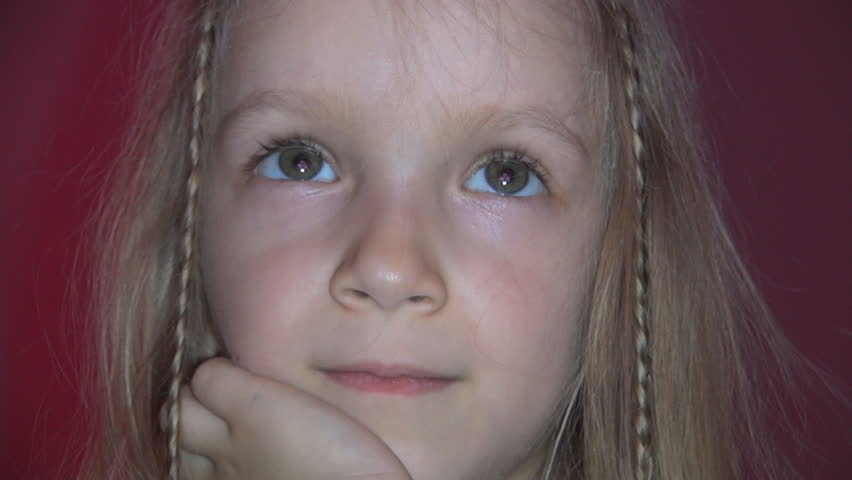ultra hd 4k child eyes watching tv in the evening  portrait of sleepy little girl face lying on