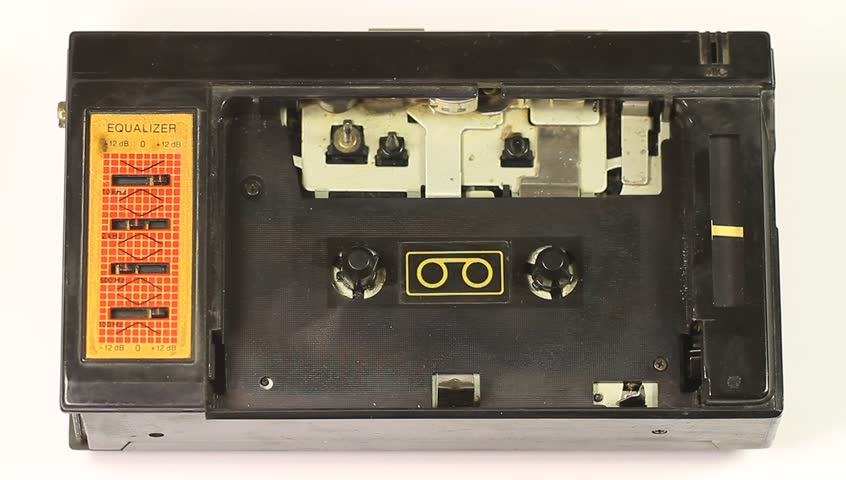 Tape recorder. Inserting and playing cassette in the tape player.
