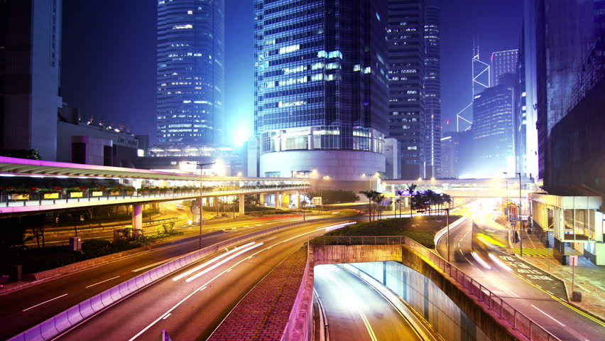 Hong Kong City Night Timelapse. Wide Shot. Office buildings under fast moving cloud. Busy traffic on highway. | Shutterstock HD Video #5598731
