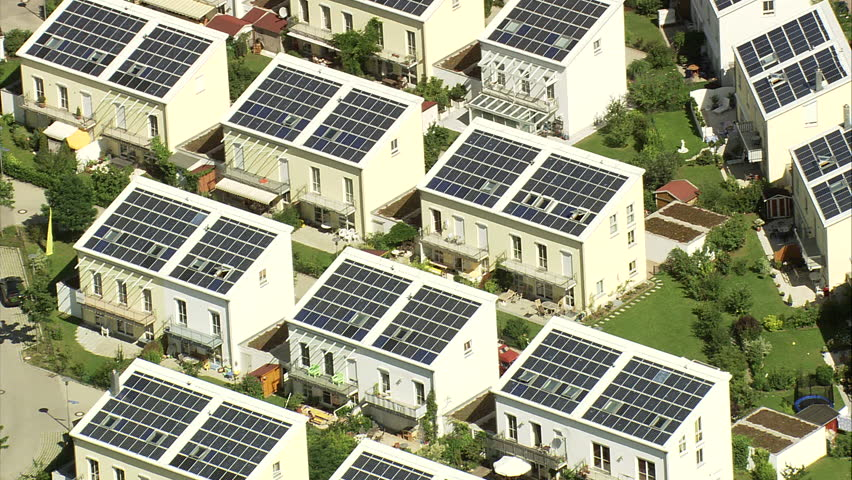 Houses with solar power panels in Germany - Estate with solar panels on roofs of houses in Germany #5601917