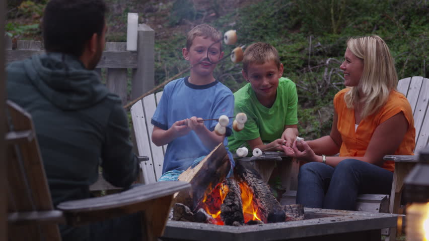 Family Roasting Marshmallows By Outdoor Fire. Shot On RED ...