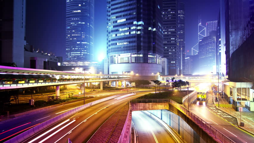 City Night Timelapse. Zoom In Shot. Office buildings under fast moving cloud. Busy traffic on highway.   Shutterstock HD Video #5608739