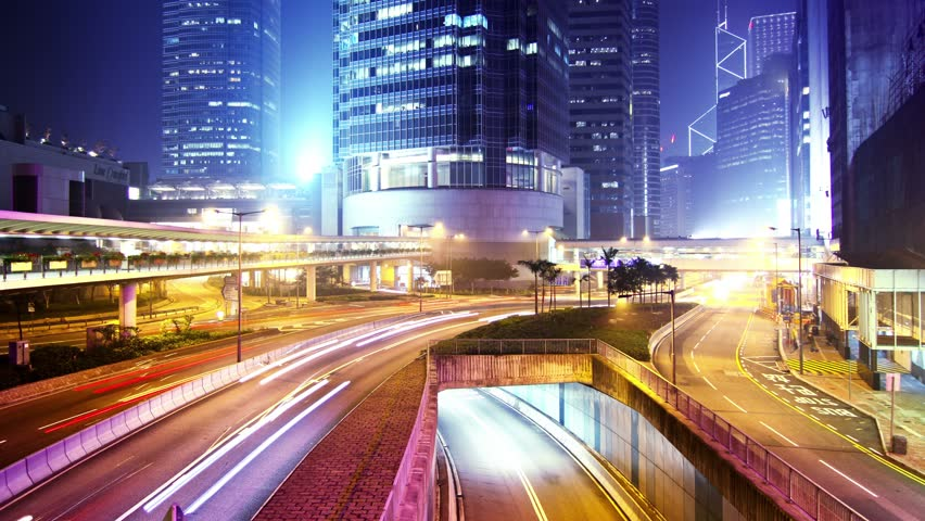 Hong Kong City Night Timelapse. 4K Zoom In Shot. Office buildings under fast moving cloud. Busy traffic on highway. | Shutterstock HD Video #5615435