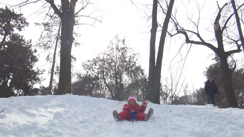POV of a Child Sledding in Snow, View of Little Girl Playing, Accident while Sledging in Park in Winter - HD stock video clip