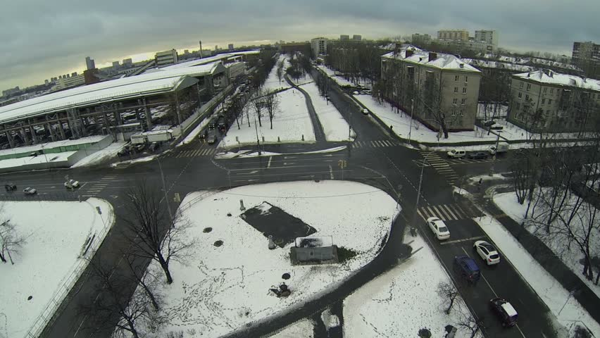 Cars start ride by crossroad at winter day in snowbound city | Shutterstock HD Video #5626406