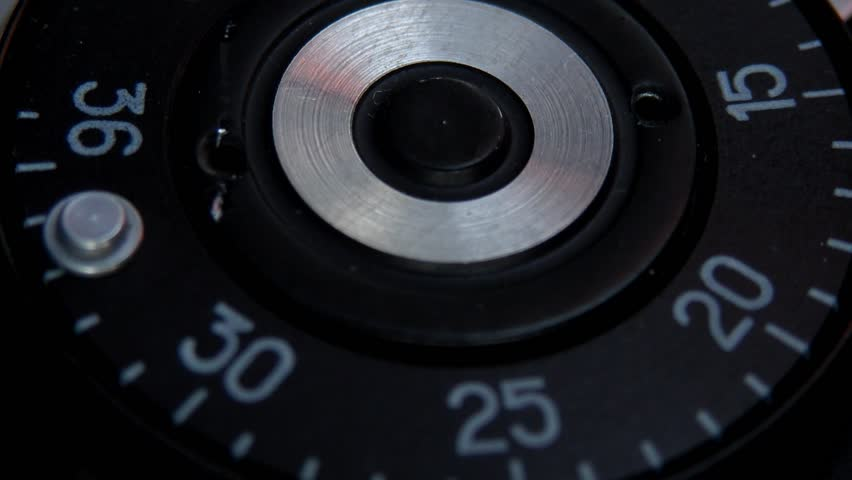 Close up shot of an old camera´s shutter button and a man pressing it/Shutter button being pressed