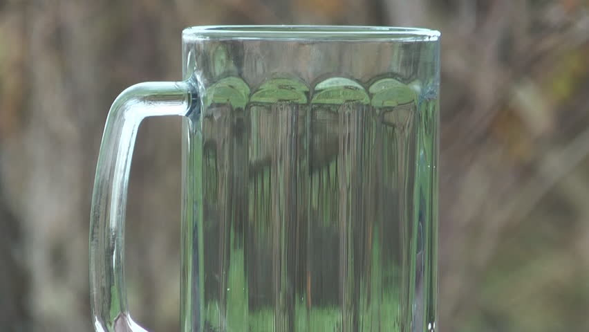The beer stream fills a mug a close up. - HD stock video clip